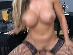 Kris Slater has sex with gorgeous blonde cougar with massive fake tits Tyler Faith. She stays in fishnets and high heels before getting twat licked and banged hard.