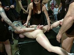 A hot blonde whore with tattoos gets tied up and abused by kinky men and women in this hot bondage scene with a lot going on!