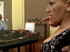 Playing poker over the table she goes nuts. She lets those horny studs touch her boobs so they knead them actively. Kinky blond mom enjoys the evening.