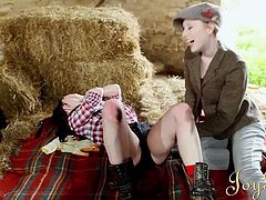 Samantha Bentley and Satine Spark are two dykes that head out to the barn to get nasty. They kiss each other with a passion that only lesbians have. The dark haired woman opens her blouse to have her tits licked and then she gets her wet pussy eaten by the blonde.