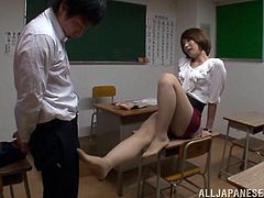 Tamaki Nakaoka has made one of her students stay after class to help her clean up. She likes her student and teases him with her sexy. She rubs her pantyhose on his crotch and undoes his trousers to suck his dick
