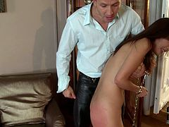 Perverse white dude calls up a steamy Japanese prostitute. He puts chains on her hands and legs and later slaps her baggy ass with pressure. Later she stands in doggy to expose her brown anal hole for hard fingering.