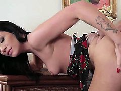 Sexy Jesse enjoys as a huge cock penetrates her wet tight pussy and later gives him a blowjob
