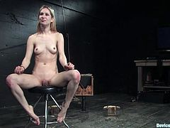 A skinny blonde chick gets trapped by bondage machines and gets her nipples yanked hard, hit play and check it out! It's hot!