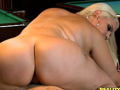 Zealous hot blondie can mesmerize you with her huge boobs and appetizing rounded big ass. This gal gets bored while playing billiard. That sucks! So torrid chick begs to polish her wet pussy from behind right on the billiard table as tough as possible.