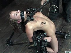 Cute chick in extreme bondage scene with devices