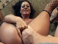 Sandra Romain is wearing sexy black stockings and got her tight butthole stuffed with massive cock. He couldn't resist and jizzed on her big jugs!