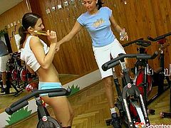 Fit and slim sexy teen hotties work out a lot in a gym to keep gorgeous shape. They get too horny and hot while working out so they start sweaty lesbian sex right there and then.