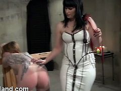 If you enjoy femdom and submission you can't miss these horny lesbian chicks. One got her round booty spanked by her mistress!