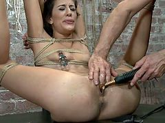 Tied up tightly and with her sexy legs spread really wide Lyla barely waits to receive a treatment that only her skilled executor knows how to apply. She receives clamps with weights on those hard nipples and then her cunt is rubbed with a metal vibrator. Wonder what else she will delight with?