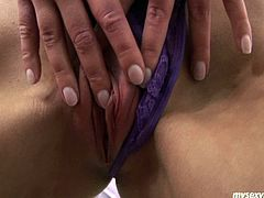 Tracy is slim brownhead chick. She wears purple color swimsuit posing on cam. She exposed her appetizing boobs caressing them sensually. Then she sides thongs rubbing wet slit. She plugs sex tool in slick wet clam poking actively.