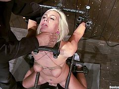 There's all sort of BDSM stuff in this video where a blonde is going through bondage, torture and toying, apart from other kinky stuff she suffers.