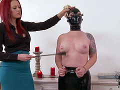 Angel Deelight is a masked slave girl that gets her perky natural tits and round as spanked with no mercy by red-haired dominatrix. Watch obedient girl stand still and get punished.