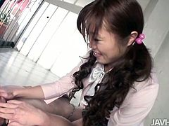 Tasty looking Japanese student in sultry college uniform rubs her big milky tits and soaking vagina with hands while her foot is busy giving foot job to sturdy penis.