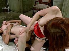 Calico the sexy redhead babe gets tied up. After that she gets humiliated by two horny bitches. Later on she gets fingered and toyed in both holes.