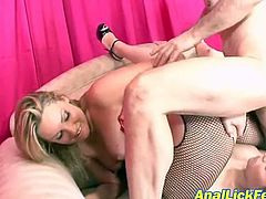 Two voracious blond sluts in steamy fishnet pantyhose and latex lingerie fuck hard with a cocky wanker. They tongue fuck each other's shaved pussies while getting anal fucked in steamy FFM sex video by Pornstar.