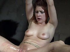 Chicky Clarissa is involved into some hardcore bdsm action. She is all tied up in the dungeon and got her dirty pussy stretched wide!