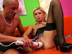 Filthy blond prostitute in sleek leather lingerie and black stockings rides a kinky dude in reverse cowgirl style tickling her snatch with a vibrator before they switch to missionary position in peppering sex clip by Tainster.