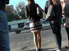 Horny voyeur likes filming hot babe under her skirt during public upskirt session