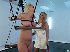 Cherry is tied up and has her tits propped up by her dominant master Lea. The domme takes an electric zapper and runs it over her slave's stomach, legs and boobs. The slave enjoys the tingling sensation and the pain that shoots through her body.