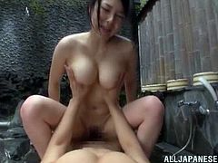 This smoking hot Japanese babe works at the sauna giving sexual service. So this time his client fucks her outdoors, nearby the hot tub!
