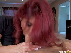 Ryder Skye is a sex obsessed red-haired mommy that seduces her daughters boyfriend with ease. She pulls out her massive boobs and gives great titjob after sucking his beefy stiff cock.