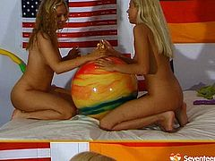 Frisky blonde babes with svelte fresh bodies strip one another teasing and warming up for lesbian fuck. They kiss passionately while stripping. Then they both play with toys.