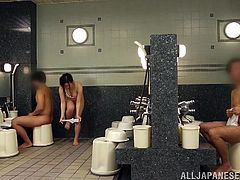 Naughty Japanese chick with hot tits kisses with some dude in the bathhouse. After that she gives a blowjob and gets fucked from behind.