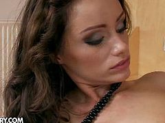 Madlin and Sophie Lynx are two pretty brunette lesbians who get pretty steamy on bed as they suck each others perky tits and nipples. Warming up their pussy with their tongues and fingers before banging it hard with a toy dick.