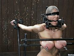 There's some really kinky BDSM action in this video where a brunette chick with big tits gets them squeezed while she's blindfolded and has her pussy toyed.