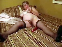 Horny Big Beautiful Grandma pleases herselfon the bed