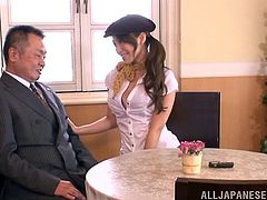 Lovely Japanese chick gives a footjob to a guy and then takes her jeans off. After that she turns around and gets fucked from behind.