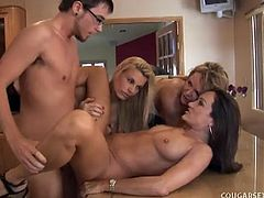 Before he gets to bang these three skanky cougars, he bangs their warm mouths until his dick is starving for a pink pussy. All of them are busty!