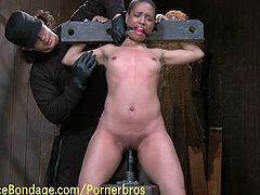See a horny ebony belle getting tied up and gagged by her master in the dungeon while riding a big dildo with her sweet pussy.