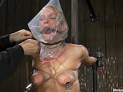 This bitch gets tied up and the sadist fuck puts a plastic bag on her fucking head, hit play and check this extreme bondage scene out!