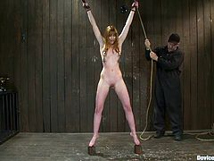 Check the gorgeous and beautiful redhead chick Marie McCray getting her tits tortured with clothespins and her pussy toyed by this dude in a kinky BDSM session.