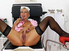 This is Naughty Head Nurse Ellen with chubby body, big saggy boobs and huge beef curtains. She demonstrates her hairy cunt in close-up shot stretching pussy folds wide. Then she inserts sex toy in the hole solo masturbating actively in XXX free sex video.