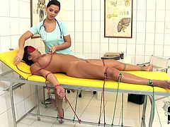 Busty patient finds herself at the mercy of whicked doctor. She is tied up and blindfolded. Horny doctor proceeds to pump her wet snatch with gloved fingers.