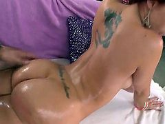 Tempting cheep looking redhead bitch Kelly Divine with tattoo on lower back and huge juicy tits gets licked and fucked hard from behind to loud orgasm by her randy lover.
