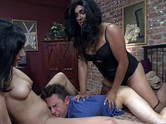 Tyler Wood gets fucked in the ass by Vaniity while he has his face buried inside Beretta James's wet pussy. The shemale and the brunette slut fuck each other on the bed while their boy toy is crushed underneath their bodies.