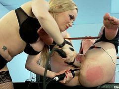 Salacious blonde milf Aiden Starr is having fun with Claire Robbins. She binds Claire and attaches wires to her pussy and then rips her cunt apart with a toy.