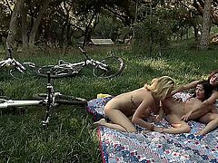In a scene that can only be described as a nod to the bygone days when dropping acid an group sex was the thing, three flower girls make and eat out with each other. And in nature.
