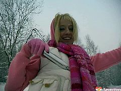 This young blond idiot doesn't think about consequences at all. She heads outdoors in snowy weather wearing a raunchy mini skirt, which she pulls up to poke her vagina with a dildo.