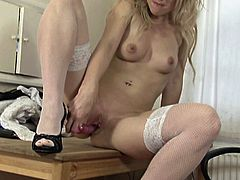 A blonde mature fucking whore gets naked for the camera and fucking sticks a hard toy in her wet-ass cunt, check it out!