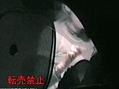 The voyeur caught this young Asian couple on tape while they were fucking in the car in a public place.