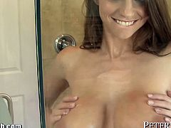 Brooklyn Chase's bouncy boobs get covered in cum after this tattooed stud slams her pussy in the bathroom.