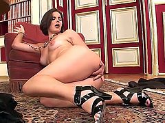 Dark haired turned on cougar Bobbi Starr with juicy ass and sexy heavy make up in high heels takes off black undies and polishes wet cunny in provocative solo session.