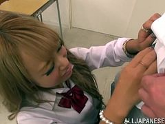 Asian girl in school uniform talks to her teacher and then drops to her knees to suck him off. Later on she gets her mouth filled with big load of cum.