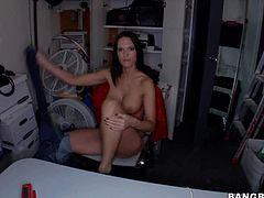 Jennifer Dark is a topless big boobed brunette in barely there tiny black panties. She shows off her amazing round tits and gets her lovely body explored by curious guy in the back room.