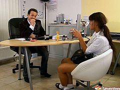 Just look at this slim brunette secretary. This chick in short skirt and too tight white blouse is the way too mad about sex. Horn-mad nympho lures her boss for sex. She spreads legs wide and lets him rub her wet pussy right in the office.